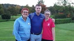 Baxter Trophy runners up Lianna Bailey and James Broderick of Kirby Muxloe with L&RLCGA President Anita Higginson