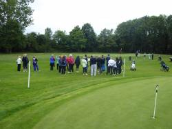Spectators at the 18th hole