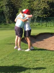 Gemma Parkes-Walley congratulates the 2018 champion Caz Parkes-Walley on the 16th green