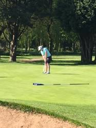 Caz holes her putt on the 12th for a birdie to win the hole