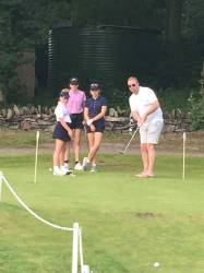 Parents have a go at putting too!!